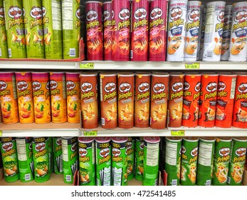 Spencer, Wisconsin - August, 23, 2016   Several cans of Prigles brand potato chips on a modern grocery shelf