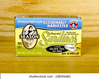 SPENCER , WISCONSIN, Dec,18,2014, Box of Season Brand Sardines in olive oil, Season Brand is a major distributor of imported sardines