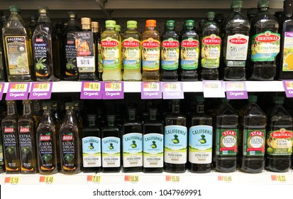 Spencer, Wisconsin, March,16, 2018   Several bottles of Olive Oil on a modern Grocery store shelf