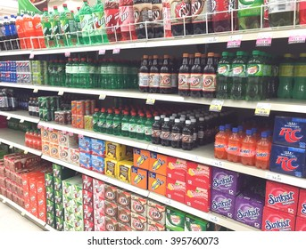 SPENCER , WISCONSIN, March,24, 2016    Several brands of soda on display in a modern American grocery store
