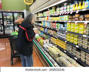 Spencer, Wisconsin, March,30, 2018   Woman Grocery shopper reading the label on a product
