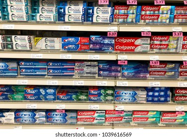 Spencer, Wisconsin, March,5, 2018   Several brands of Toothpaste on a modern Grocery Store shelf