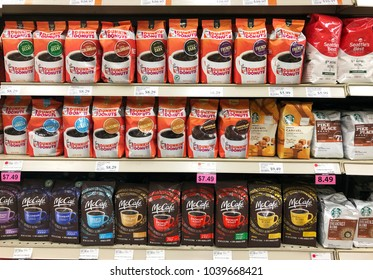 Spencer, Wisconsin, March,5, 2018   Several brands of Coffee on a modern Grocery Store shelf
