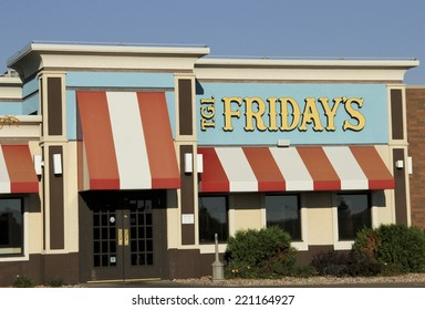 SPENCER , WISCONSIN Oct. 2, 2014:  Friday's Sign on Store Front. Fridays is an American restaurant chain focusing on casual dining.