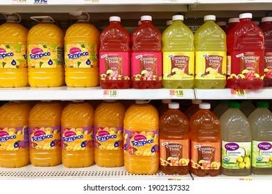 Spencer, Wisconsin, U.S.A.  January, 23, 2021    Several bottles of juice drink on a store shelf