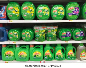 Spencer, Wisconsin,December, 10, 2017   Several bottles of Gain laundry detergent on a grocery store shelf