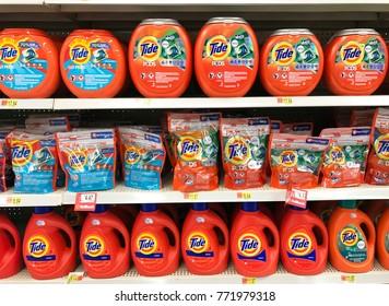 Spencer, Wisconsin,December, 10, 2017   Several bottles of Tide laundry detergent on a grocery store shelf