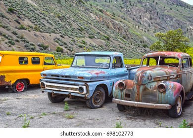 SPENCES BRIDGE, CANADA - MAY, 24, 2017: Roadside vintage cars at Vulture Garage, a store for vintage cars and antiques at Spences Bridge, BC, attracting visitors travelling on Trans Canada Highway.