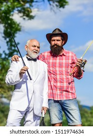 Spending good time. happy fishermen in water. Fly fishing adventures. friends men with fishing rod and net. retired father and mature son with beard. hobby of businessman. retirement fishery.