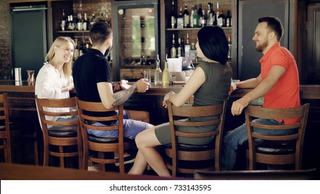 Spending time with friends. Spending time with friends in pub. Group of old friends having conversation