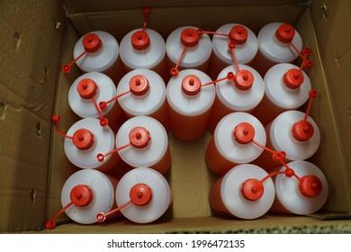Speragum used in selective focus printing houses is filled into 1 liter chemical bottles. liter bottle box. stacked bottles.