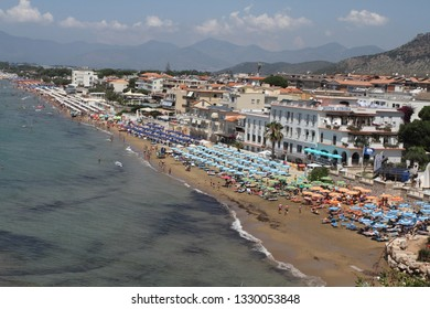 Sperlonga, Italy. 30 June 2018: Sperlonga beach crowded with tourists and swimmers for the summer season