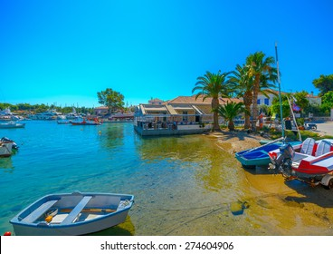SPETSES, GREECE - JUN 21, 2014: Sailing and fishing boats in Spetses island in Greece on Jun 21, 2014