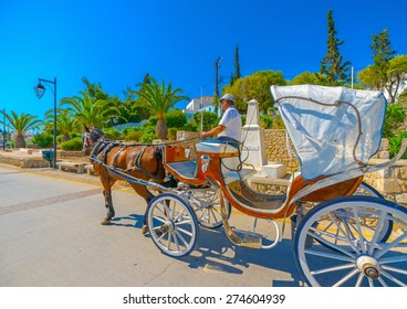 SPETSES, GREECE - JUN 21, 2014: Beautiful carriage with horse in Spetses island in Greece on Jun 21, 2014