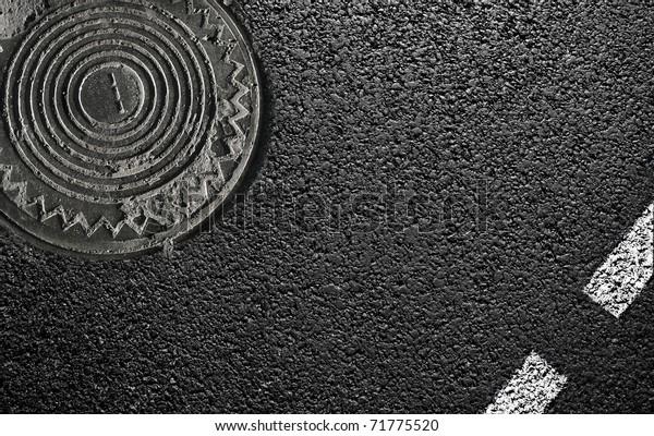sphalt and the hatch. close-up