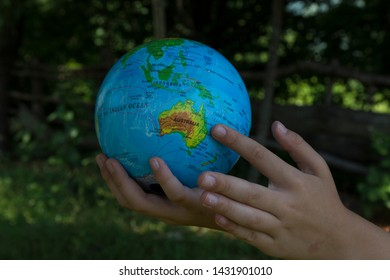 sphere on the map of the world.someone shows Australia on the map. we teach children the world.