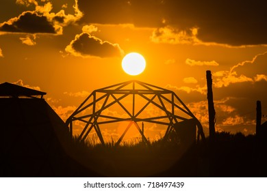 Sphere outdoor tent frame on sunset background