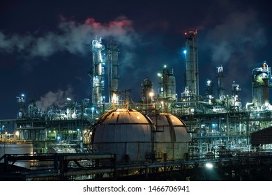 Sphere tanks gas storage in manufacturing industrial plant of petroleum  at night.