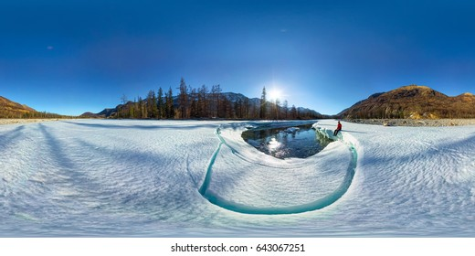 Spherical 360 180 degrees panorama of a man on an ice melting river.