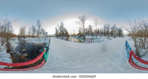 Spherical, 360 degrees panorama. Bridge over the winter river. City Park in Petrozavodsk, Russia. Birds are waiting for feeding.