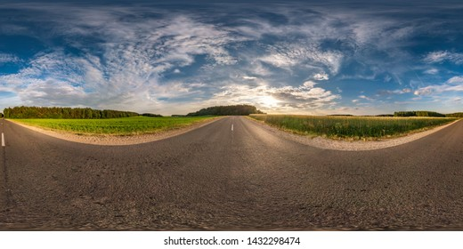 spherical hdri panorama 360 degrees angle view on asphalt road among fields in summer evening sunset with awesome clouds in equirectangular projection, ready VR AR virtual reality content with zenith