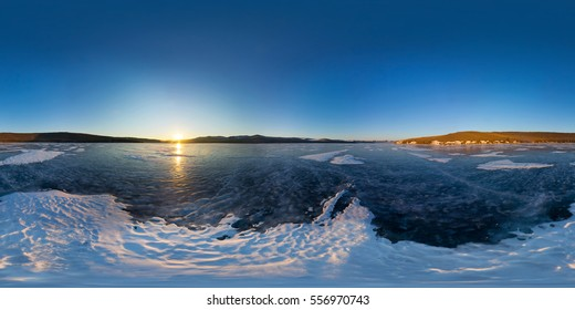 Spherical Panorama 360 degrees 180 degree sunrise on the island of Olkhon, snowy spot on the ice of Lake Baikal.