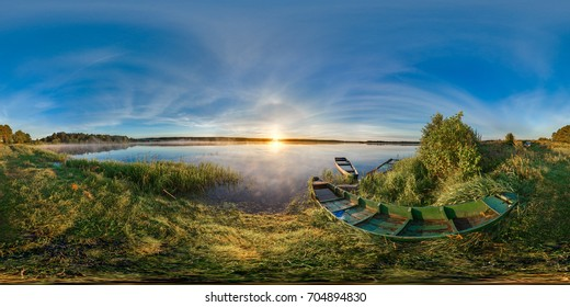 Spherical panorama. 360. Sunrise at the bank of lake. Boats on the bank of lake. Landscape.