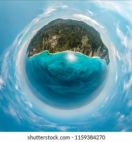Spherical panorama of a little planet with mountains, sea coast, long beaches, rocks, beautiful turquoise and blue sea. View on the Megali Petra and Kavalikefta beach.