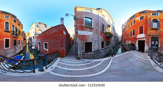Spherical panorama of a small street with bridge over canal in Venice city at sunny day