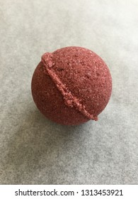 spherical red homemade natural bath bomb for beauty ritual. handmade cosmetics.