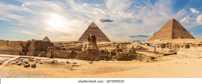 The Sphinx by the Great Pyramids of Egypt near the ruins of a temple in Giza