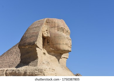 sphinx face in front of khufu pyramid with blue sky giza cairo egypt