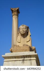 Sphinx of Horemheb, Serapeum, Alexandria with Pompey's Pillar in backgrouns.