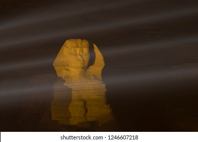 Sphinx with laser rays in the night