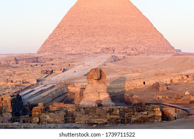 Sphinx laying down in front of the great pyramid of Giza in Cairo- Giza- Egypt