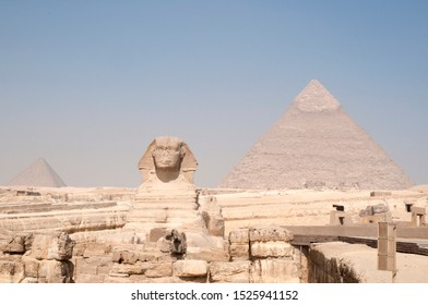 Sphinx and Pyramids  against a blue back ground