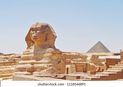 The Sphinx and pyramids on a cloudless day. Giza, Egypt.