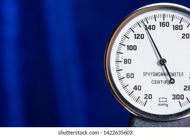 sphygmomanometer closeup blood pressure measurment medical equipment. Tonometer, part of medical tool on blue background, close-up high resolution.