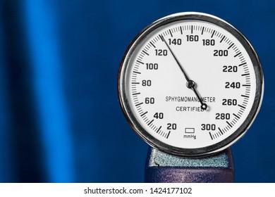 sphygmomanometer closeup, blood pressure measurment medical equipment. Tonometer, medical tool on blue background, close-up high resolution.