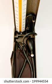 Sphygmomanometer with hand and white background