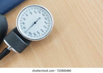 Sphygmomanometer on a wooden table.