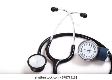 sphygmomanometer and stethoscope on white background.