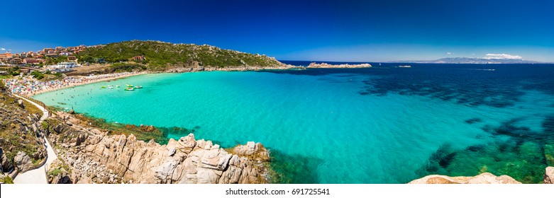 Spiaggia di Rena Bianca beach with red rocks and azure clear water, Santa Terasa Gallura, Costa Smeralda, Sardinia, Italy.