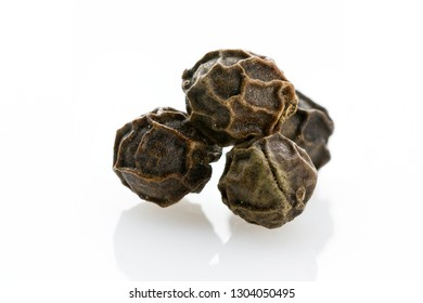 Spice. Black peppercorns with a pronounced texture close-up on a white background