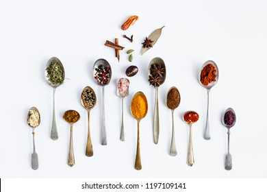 Spice and herbs flat lay composition on white background. Top View of various kinds of spices and herbs with copy space for text.