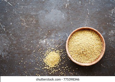 Spice mustard seeds in a bowl on a dark background. Top view