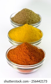 Spice Powder : Chili, Turmeric & Coriander in Bowl isolated on white background