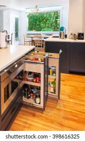 Spice pullouts in kitchen island as part of kitchen remodel