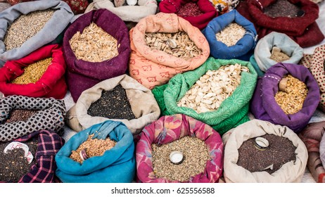 Spice seeds in colorful sacks in Leh Market