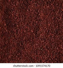 spice sumac  as background texture. Organic food, healthy lifestyle, space for text. Top view,  Flat lay